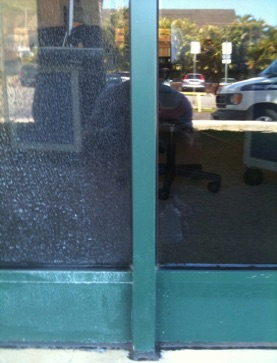 before and after results showing hard water stain removal on window at Mid Pacific Institute