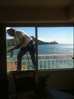 cleaning windows on balcony overlooking diamond head crater in Waikiki